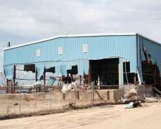 High winds damage a steel building