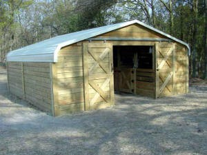 Carport to horse barn hansen buildings for Sip garage kits